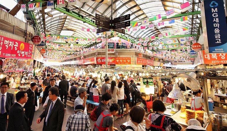 The famous Gwangjang Market in Seoul, South Korea full of people and vendors