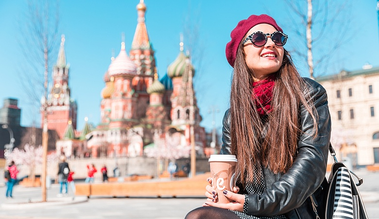 Young woman in Moscow Red Square, with Saint Basil cathedral in background
