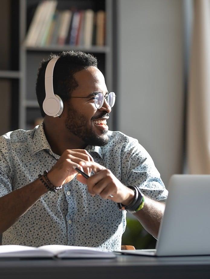 man on laptop with headphones on